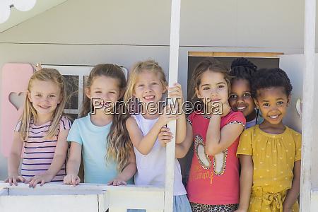 portrait of smiling girls in kindergarten