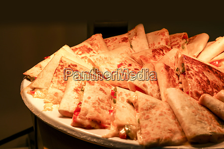quesadilla slices with cheese under a
