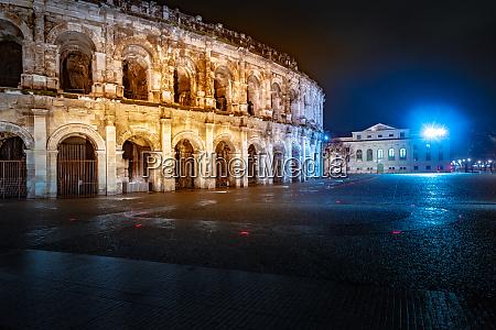 panorama of illuminated roman amphitheater in