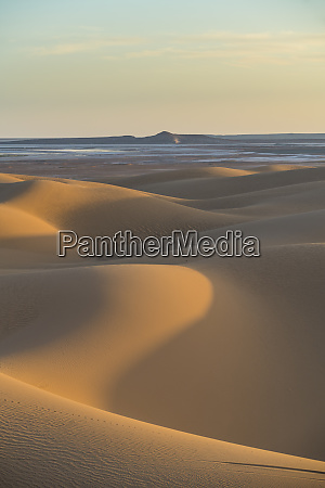 sunset in the giant sand dunes