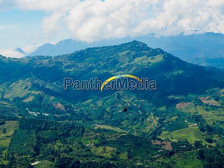 paraglider soars near jardin antioquia colombia