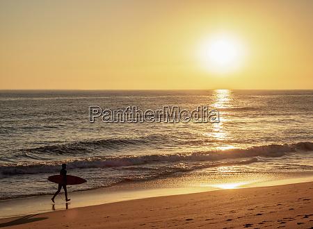 faro beach at sunset ilha de