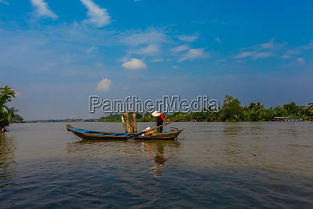 fisherman on the river vietnam indochina