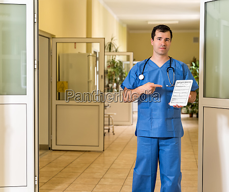 middle age male doctor in blue