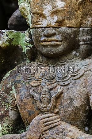 a carved dvarapala entrance guardian stone