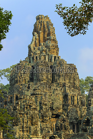 central tower and carved faces at