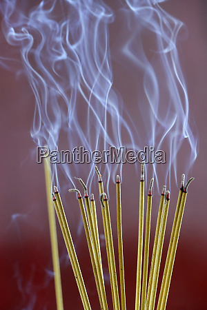 incense sticks on joss stick pot