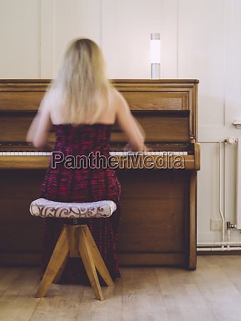 woman with motion blur playing the