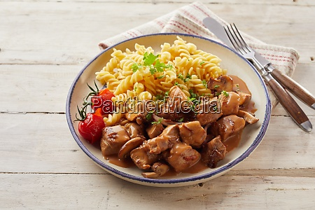 hot plate of pasta and meat