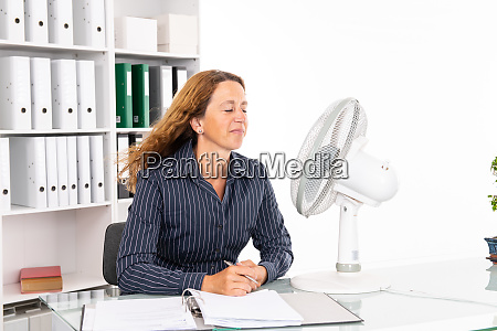 young business woman with ventilator at