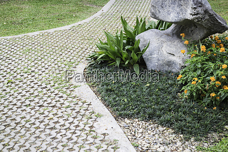 lovely garden with footpath in summer