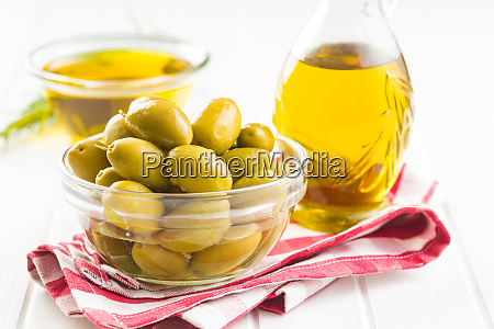 green olives and olive oil in