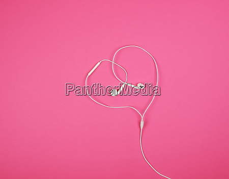 white headphones with a cable on