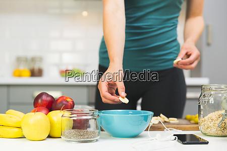woman preparing healthy fitness breakfast oatmeal