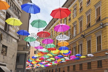 brightly coloured floating umbrellas genoa liguria