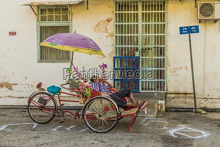 local rickshaw tuk tuk driver in