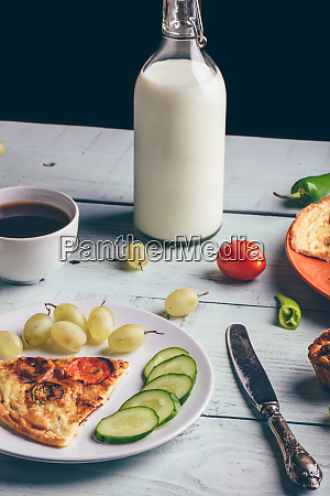 frittata and fruits vegetables bottle of
