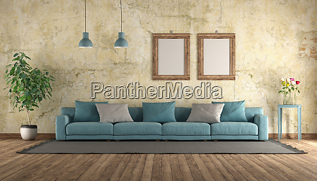 modern blue sofa in a grunge