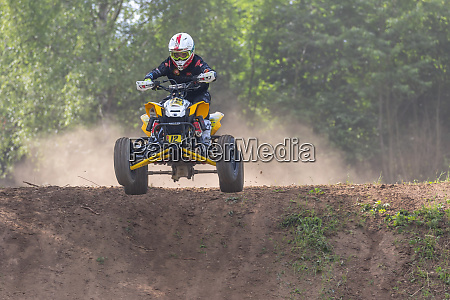 young rider overcomes a difficult terrain