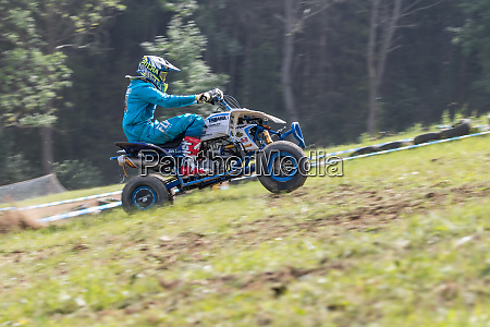 panning shot of rider in blue