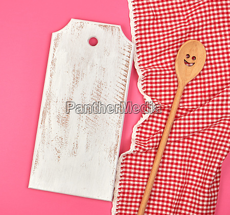 white wooden cutting board and wooden