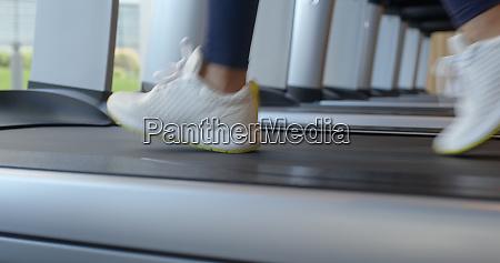 woman legs run on the treadmill