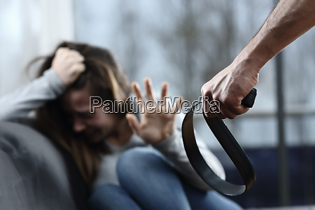 scared abuse victim being threatened at