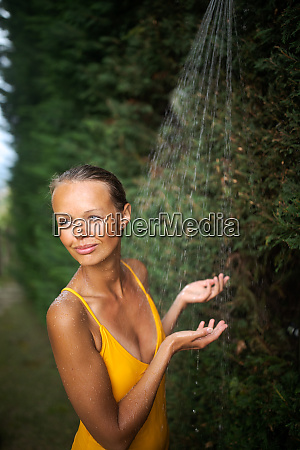beautiful young woman taking a shower