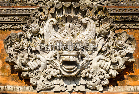 statue on a temple entrance door