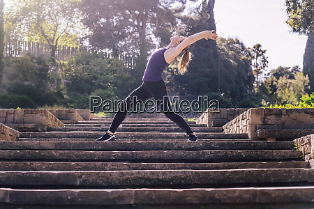 woman doing yoga exercise on the