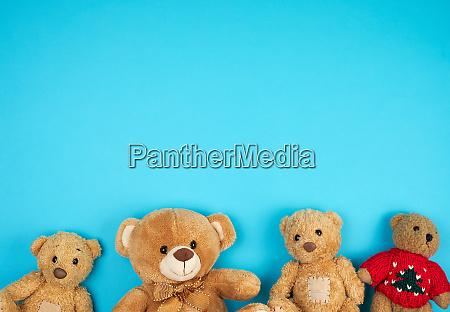 four teddy bears on a blue