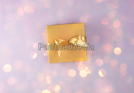 brown paper box with bow on