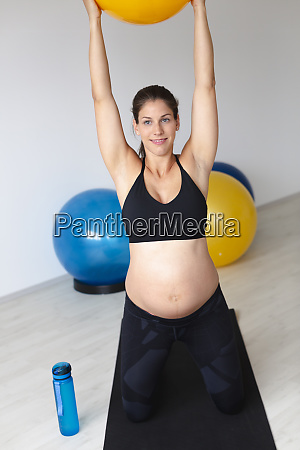 beautiful young fit athletic and pregnant