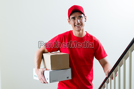 cheerful delivery man with parcel post