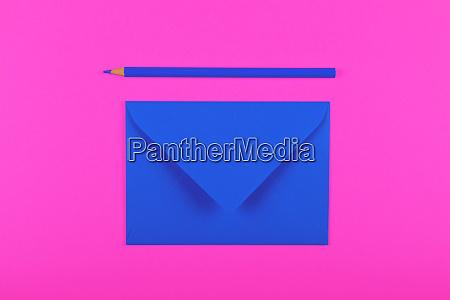 closed blue paper envelope over magenta