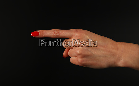woman hand pointing with index finger