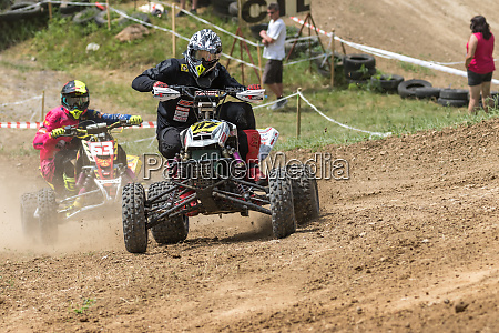 rider in black on a quad