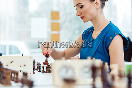 woman playing chess in tournament