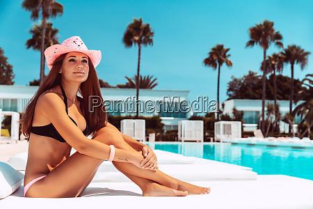 beautiful woman on luxury beach resort
