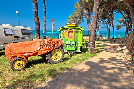 tractor camping in mediterranean beach camp