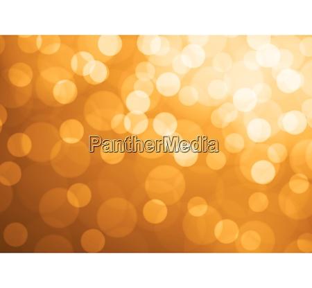 white bokeh blur light on orange