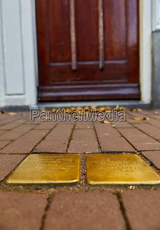 stumbling stones stolpersteine holocaust memorial placed