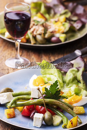 closeup of salade nicoise on dark