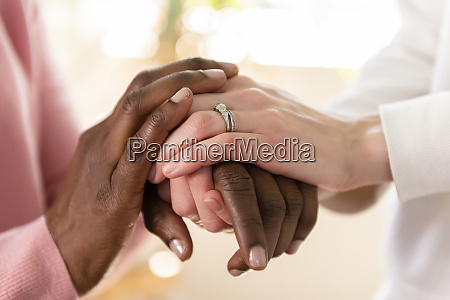 nurse holding hands of patient