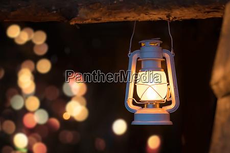 old fire lit kerosene lamp