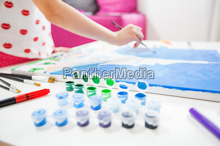 little artist hands with brush painting
