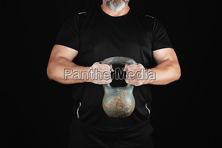 adult strong athlete in black clothes
