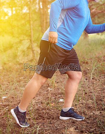 adult plump athlete in blue uniform