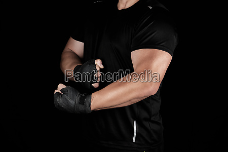 adult athlete in black uniform is