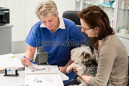 pet owner receiving guidance from the